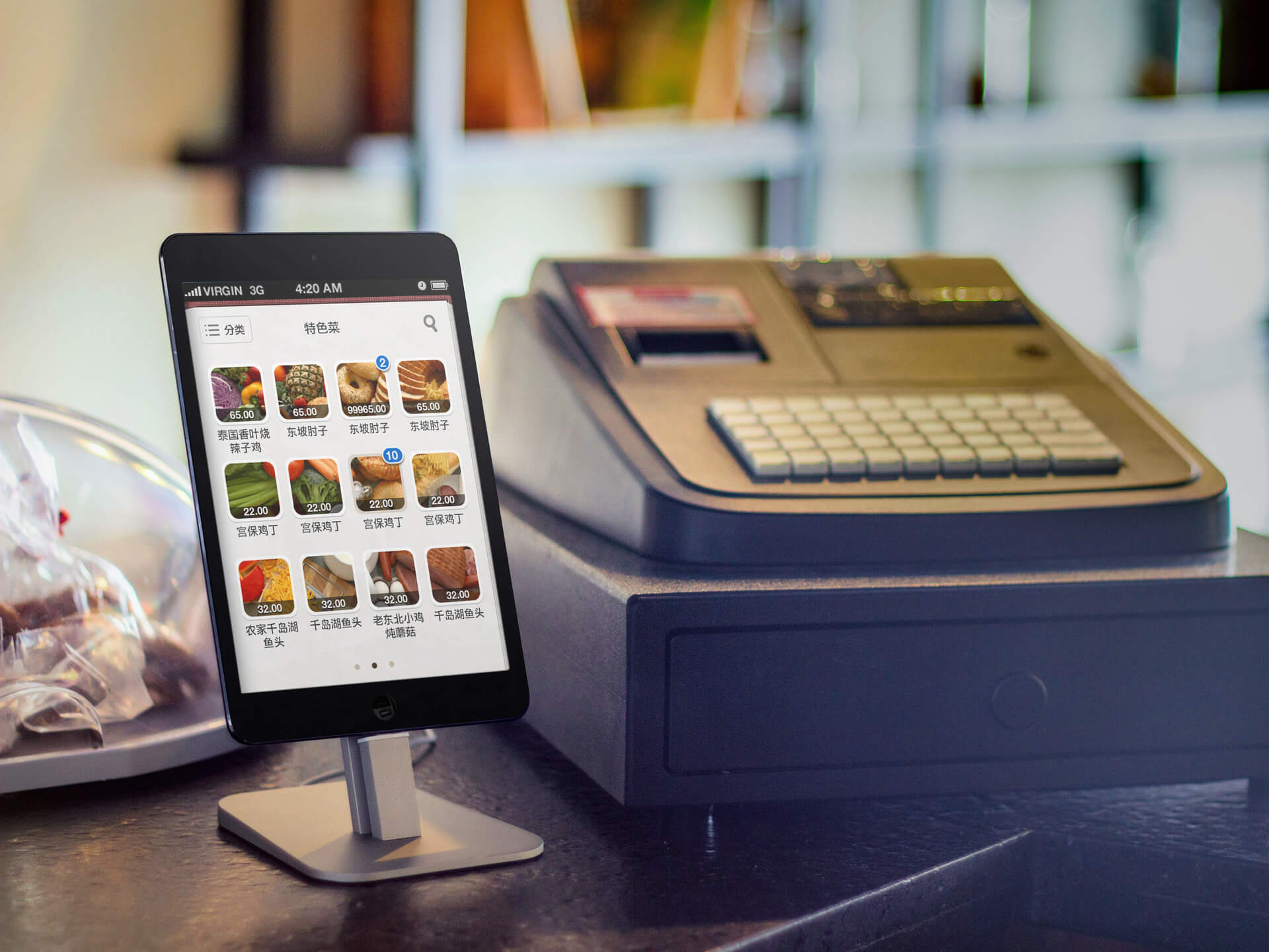 Tablet Mockup Next to a Cash Register Featuring a Grocery App
