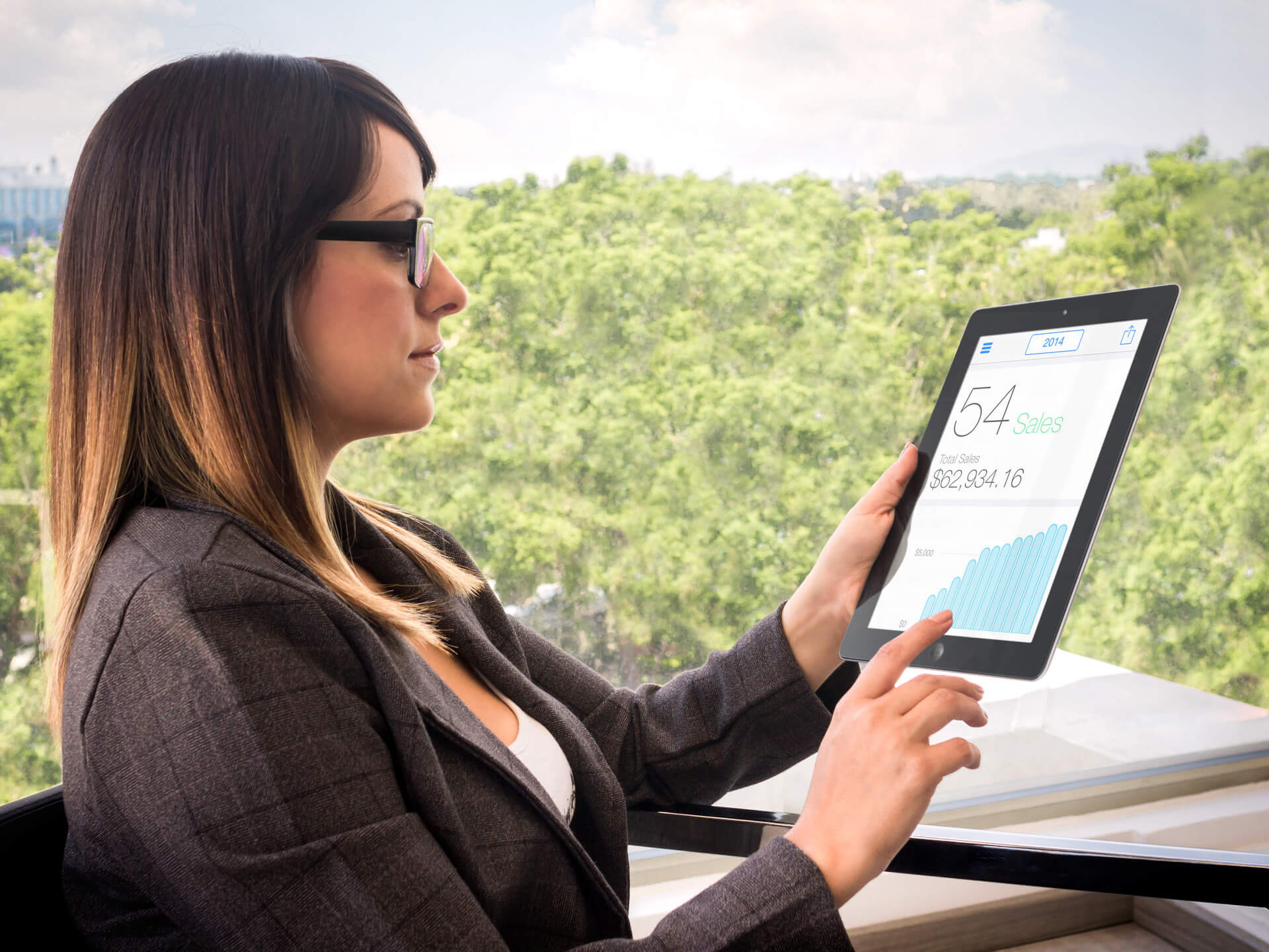 A Business Woman Using an iPad