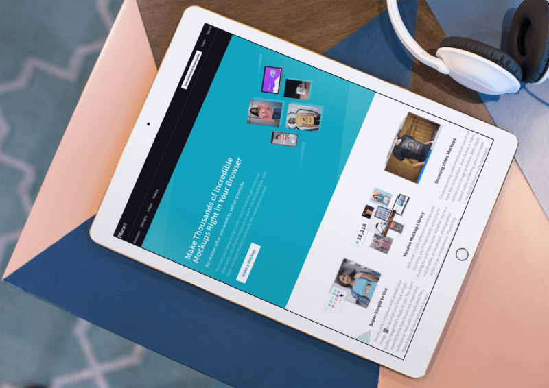 Mockup Of An Ipad Lying On The Corner Of A Multicolor Table