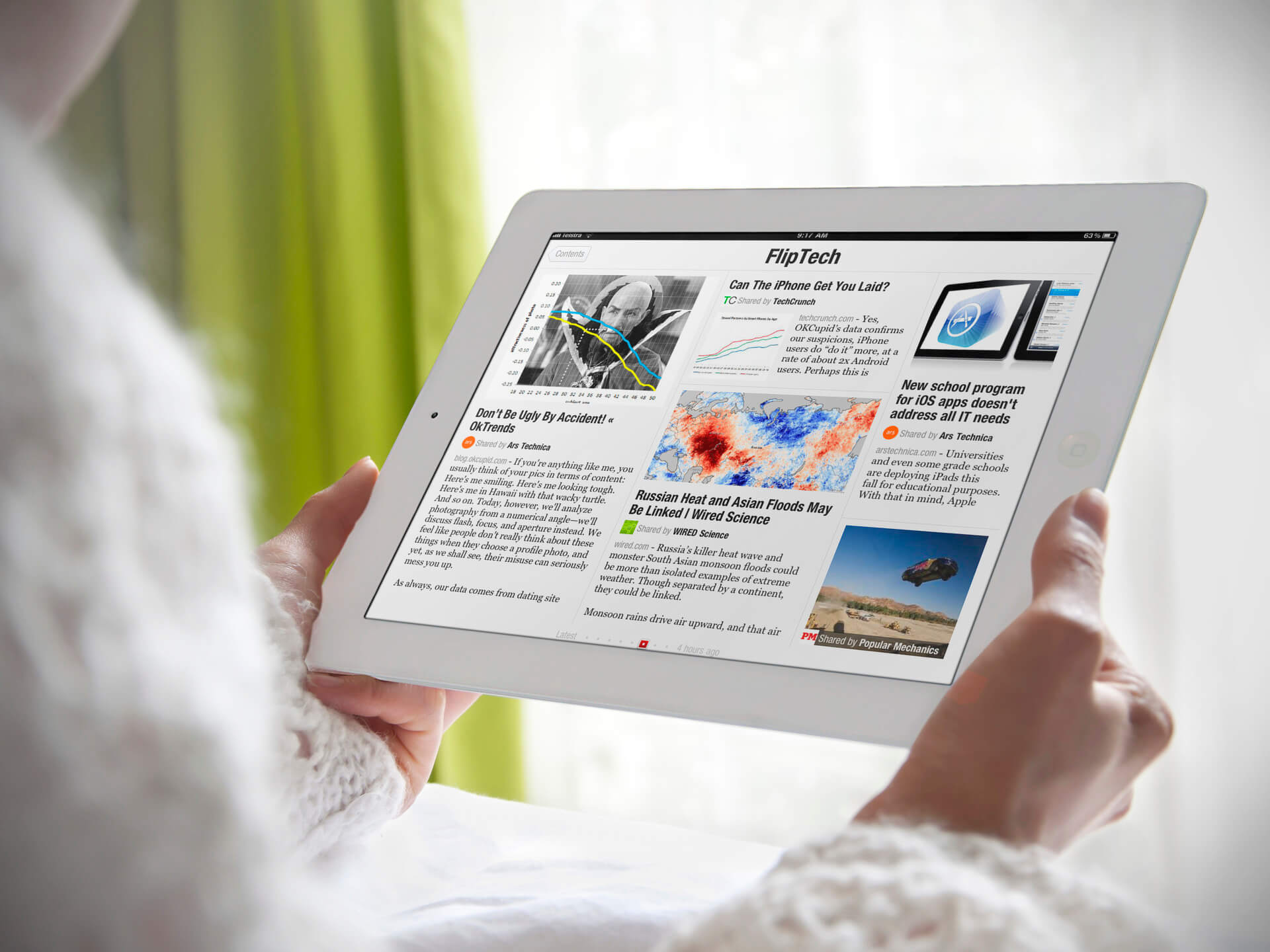 White iPad Mockup Held By a Woman in a Bedroom