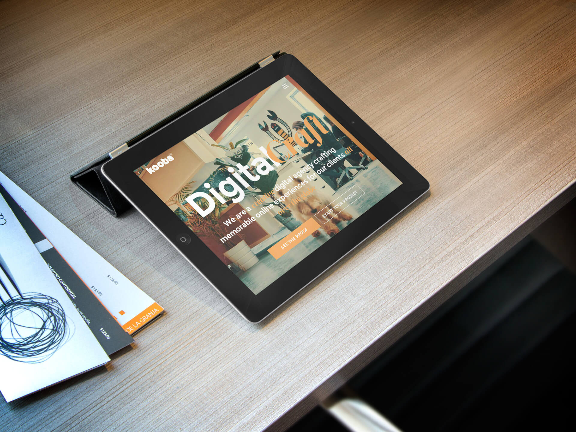 Black iPad Mockup Sitting on a Table Featuring a Design Website