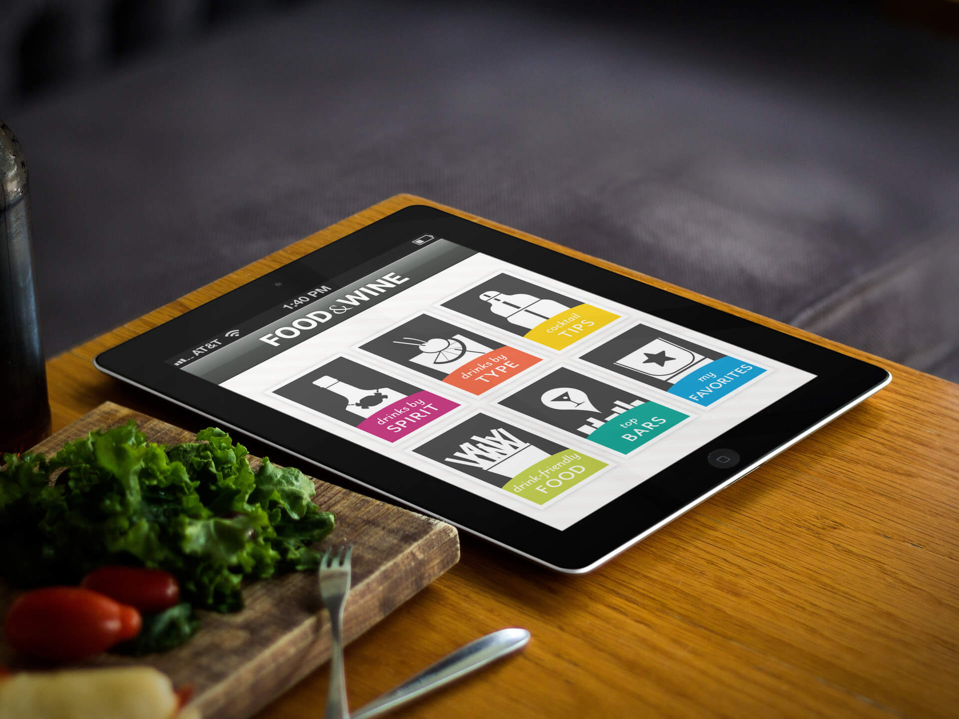 Black iPad Mockup in a Wooden Tabletop Next to a Cutting Board and Vegetables