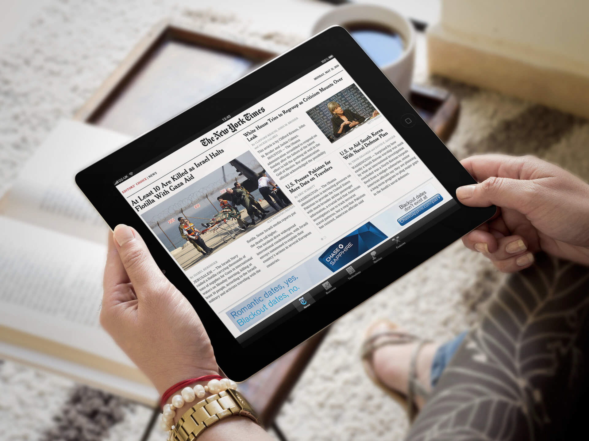 Black iPad Mockup Held By a Woman in a Living Room
