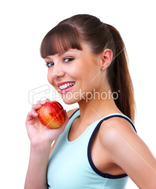 close up of a beautiful young woman eating red apple