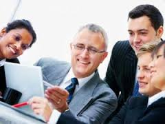 Stock Photo of a Group of Business Executives Looking at a Document