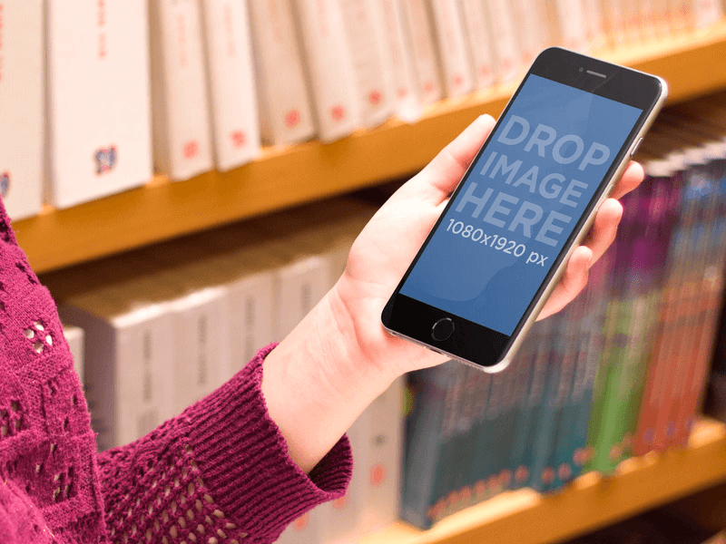 iPhone 6 Plus Mockup of Girl Using iPhone 6 Plus at the Library