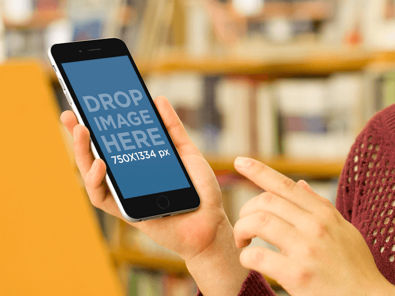 iPhone 6 Mockup of Girl Using Black iPhone 6 at the Library