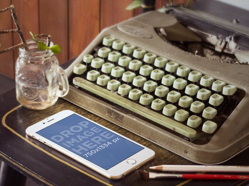 Gold iPhone 6 Mockup Next to Vintage Typewriter