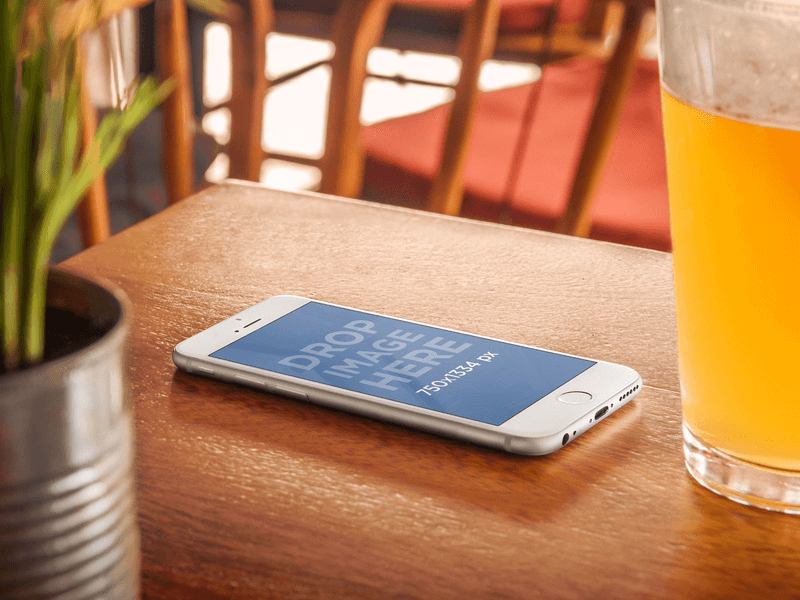 iPhone 6 Mockup on Wooden Table next to a Beer