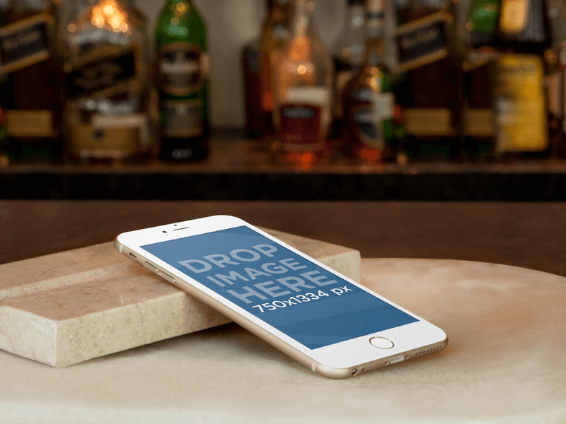 iPhone 6 Mockup Resting on Marble Bar Counter