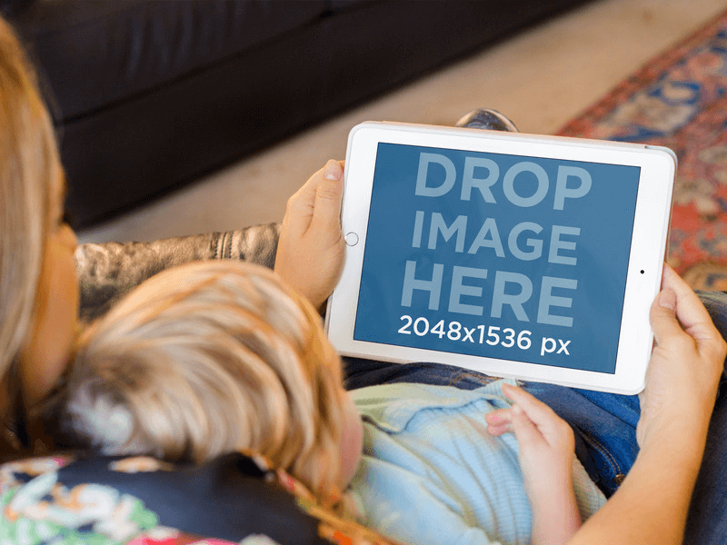 iPad Mockup of Mom and Baby Using White iPad in Sofa