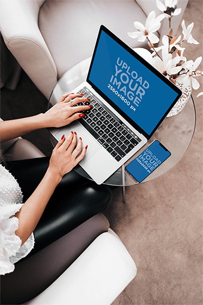 Iphone 11 Pro Mockup Of A Businesswoman Working On Her Macbook Pro