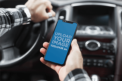 Mockup Of A Man Holding An Iphone 11 Pro In His Car