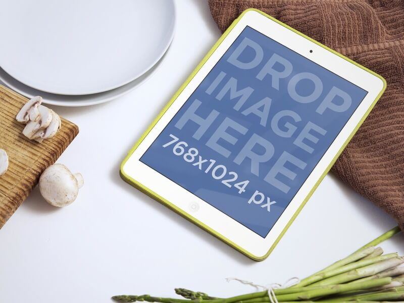 iPad Mockup of Cooking Scene With White iPad Mini