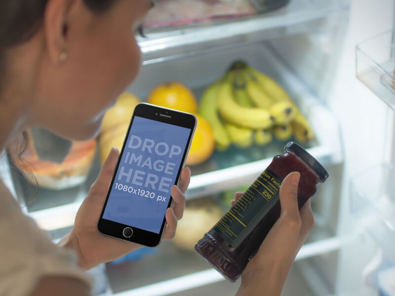 iPhone 6 Mockup of Woman With Open Fridge Looking at Nutritional Facts