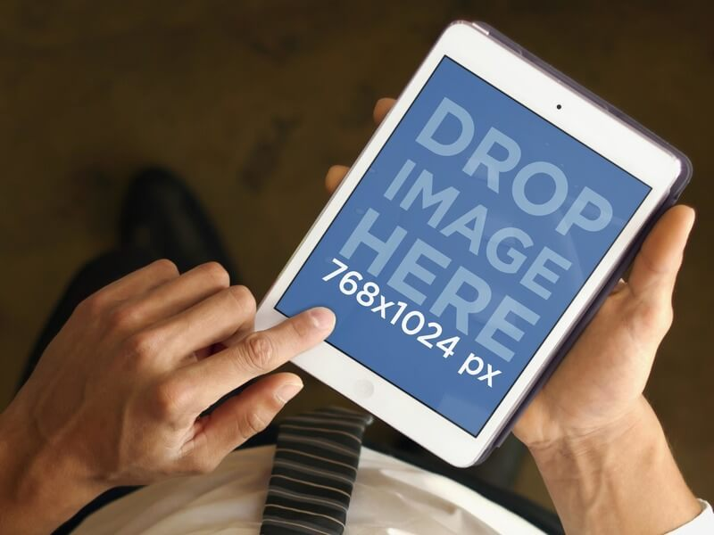 iPad Mockup of Businessman With White iPad Mini From Above