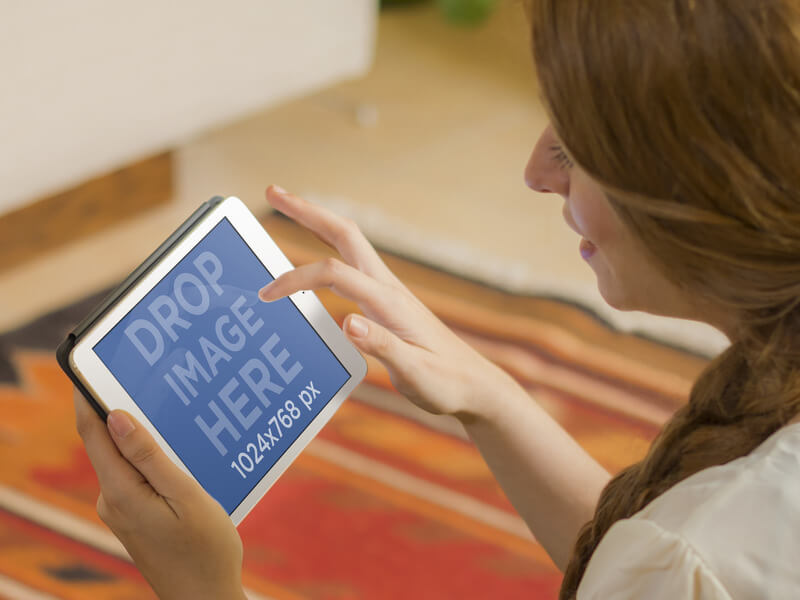 iPad Mini Mockup Template Featuring a Young Woman on a Colorful Carpet