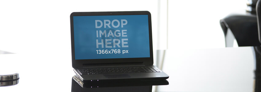 DELL Laptop Mockup Over a Glass Table