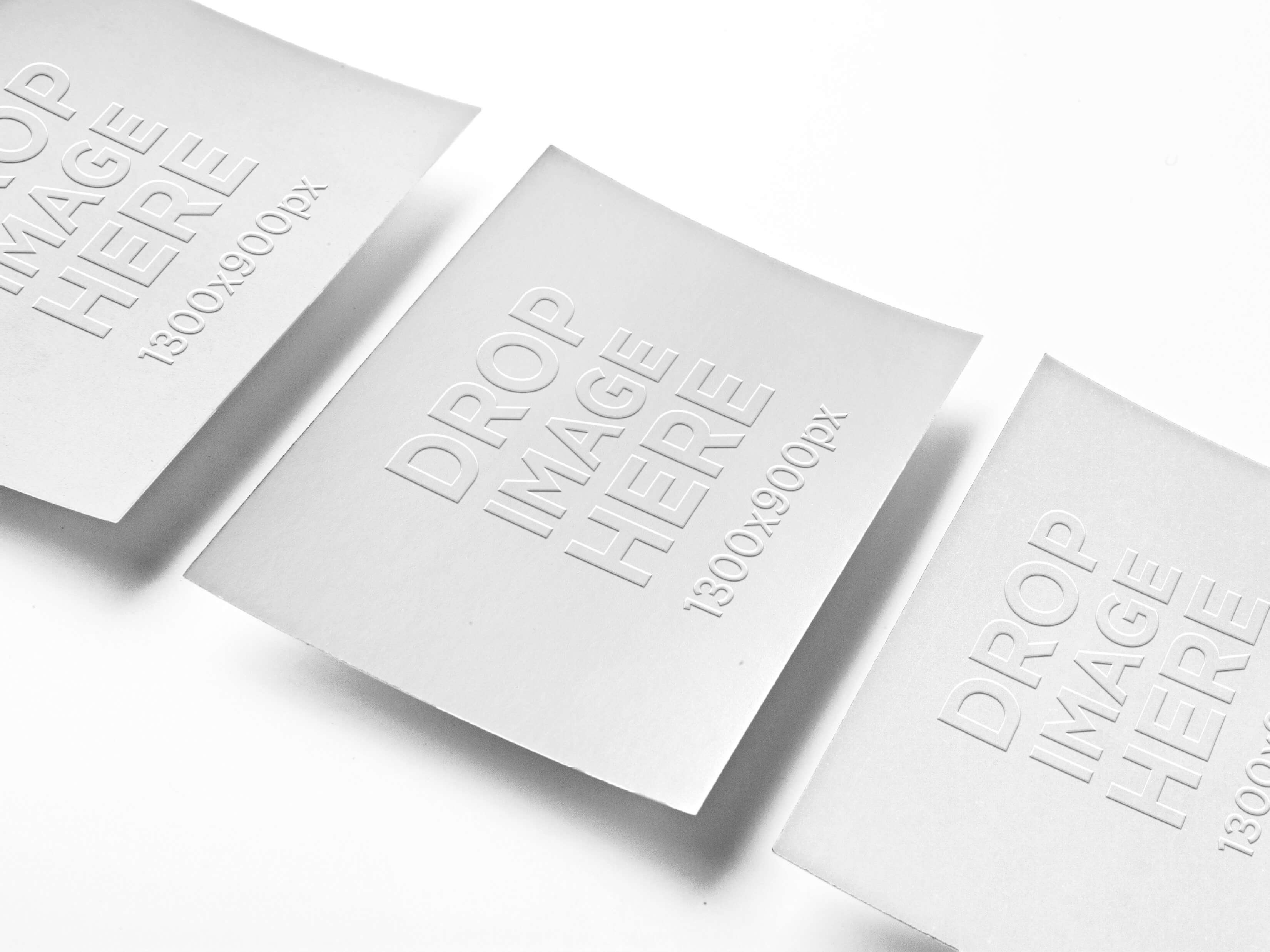 MOCKUP OF 3 BUSINESS CARDS LYING OVER A SMOOTH BACKGROUND