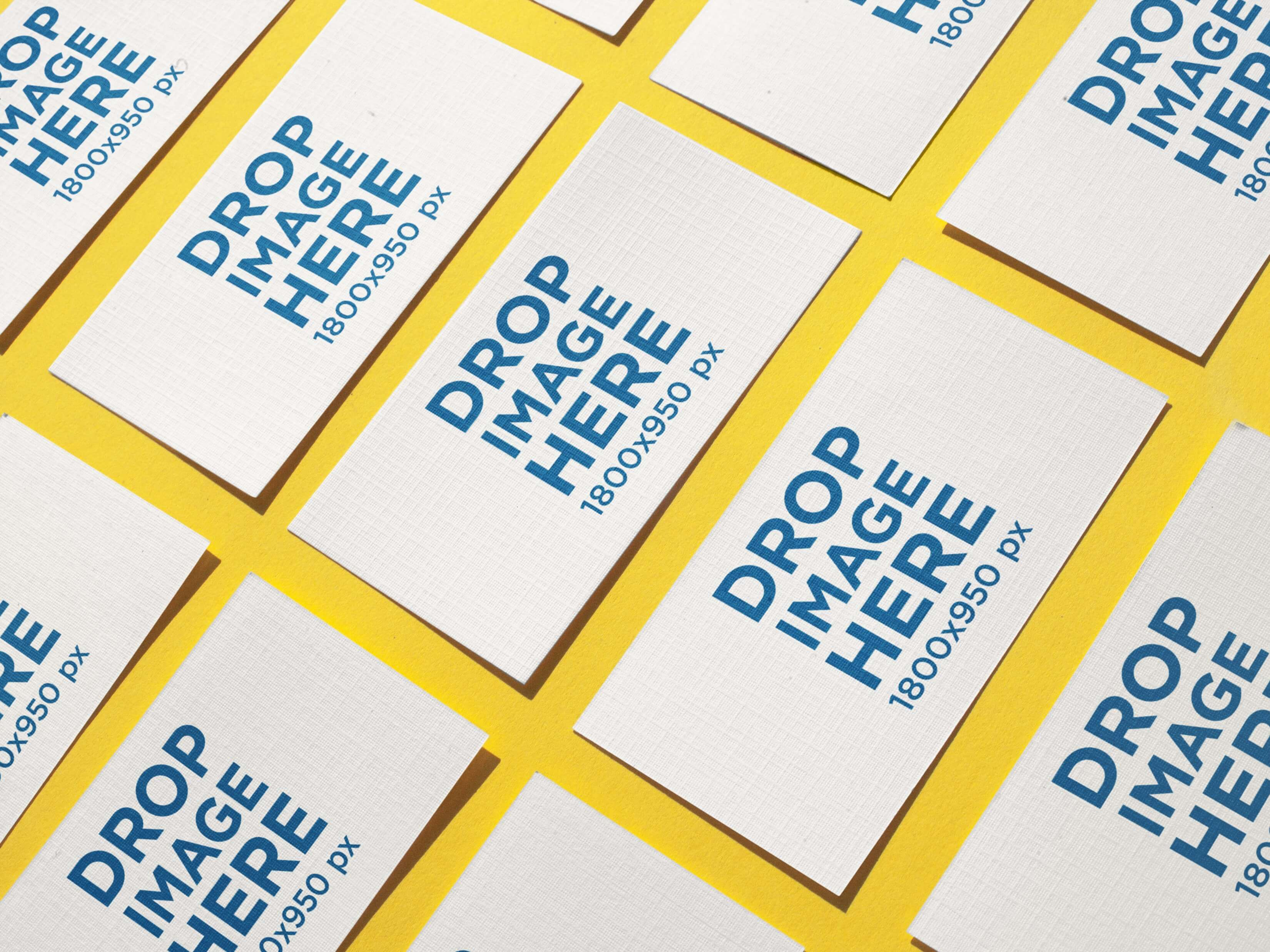 MOCKUP OF BUSINESS CARDS LYING ON A YELLOW SURFACE