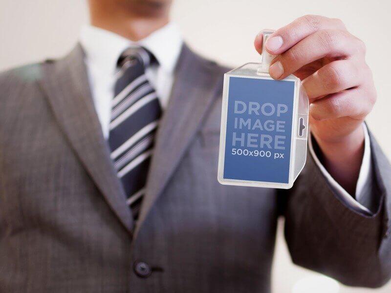 PRINT MOCKUP OF BUSINESSMAN WITH BADGE HOLDER