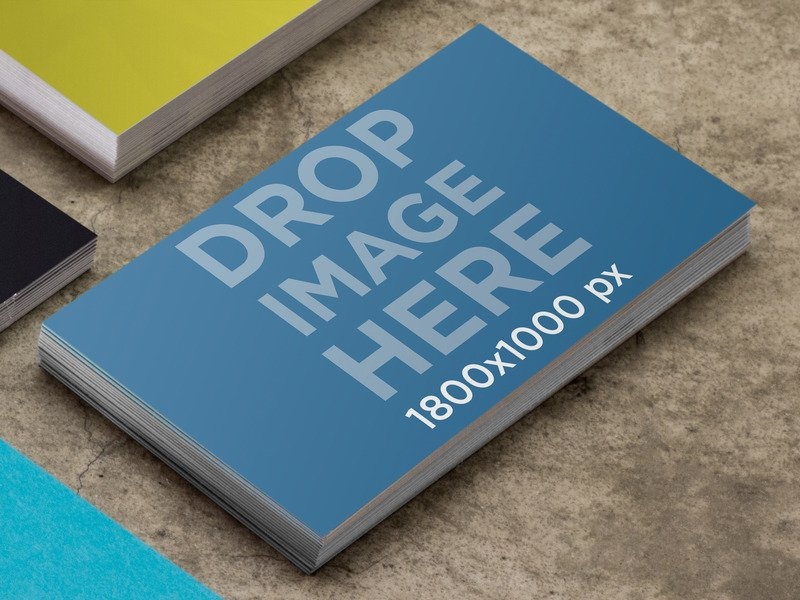 MOCKUP TEMPLATE OF BUSINESS CARD ON CONCRETE TABLE