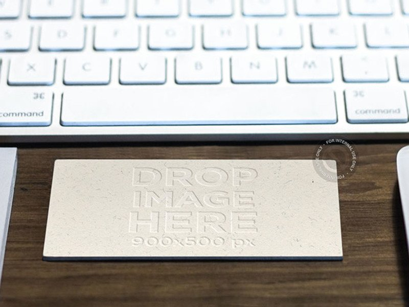 MOCKUP OF A BUSINESS CARD IN LANDSCAPE POSITION ON TOP OF A DESK