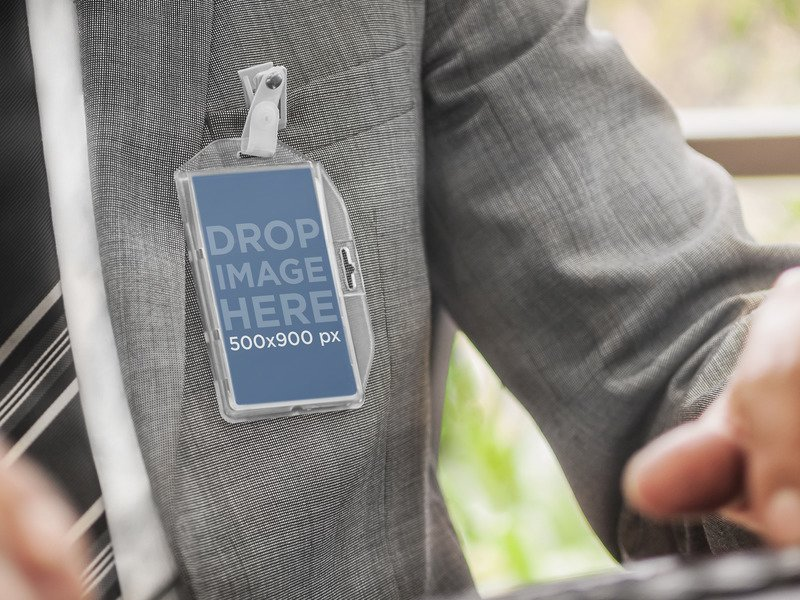 MOCKUP OF MAN CARRYING A BADGE HOLDER AT THE OFFICE