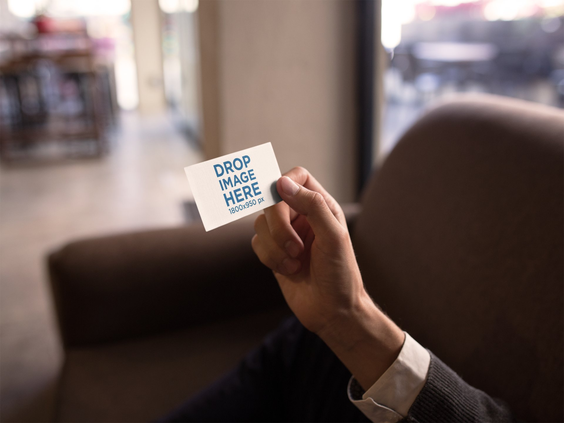 BUSINESS MAN HOLDING A BUSINESS CARD MOCKUP