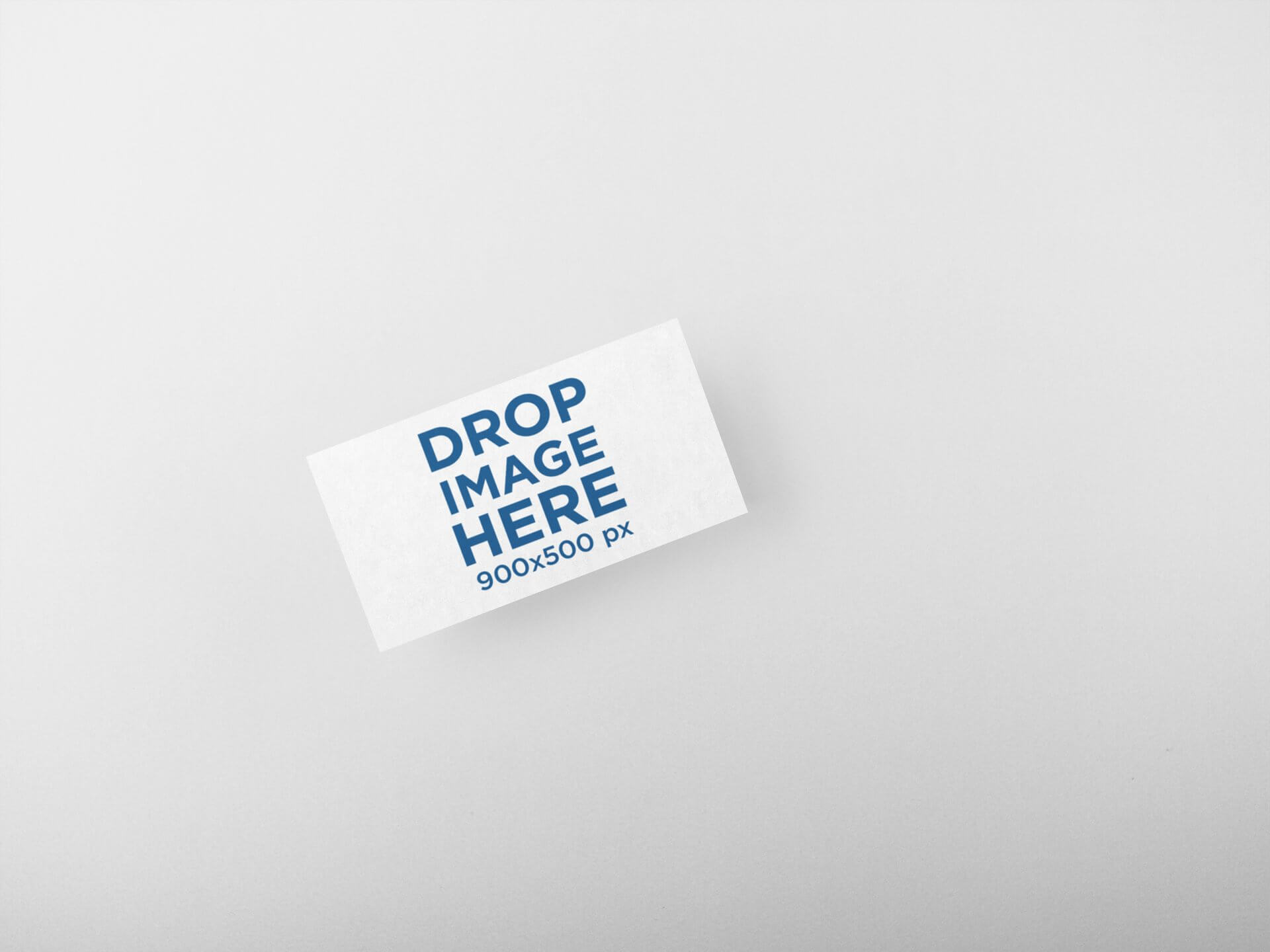 BUSINESS CARD MOCKUP LYING ON A SOLID SURFACE