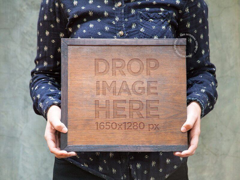 Branding Mockup Featuring A Man Holding A Wooden Box
