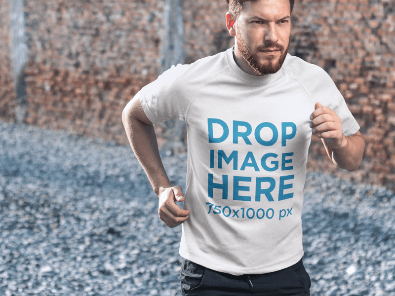T-SHIRT MOCKUP FEATURING AN ATHLETIC HANDSOME MAN JOGGING