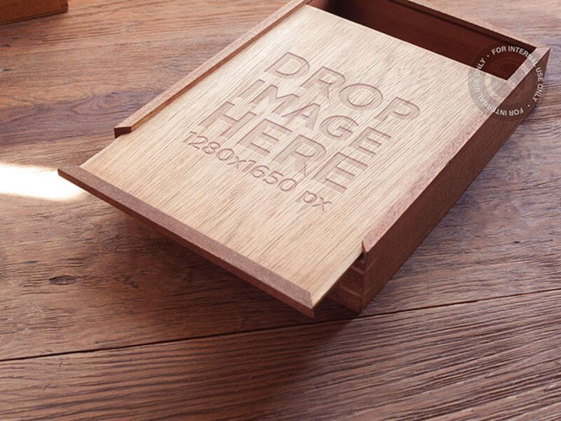 BRANDING MOCKUP FEATURING A WOODEN BOX ON TOP OF A WOODEN TABLE