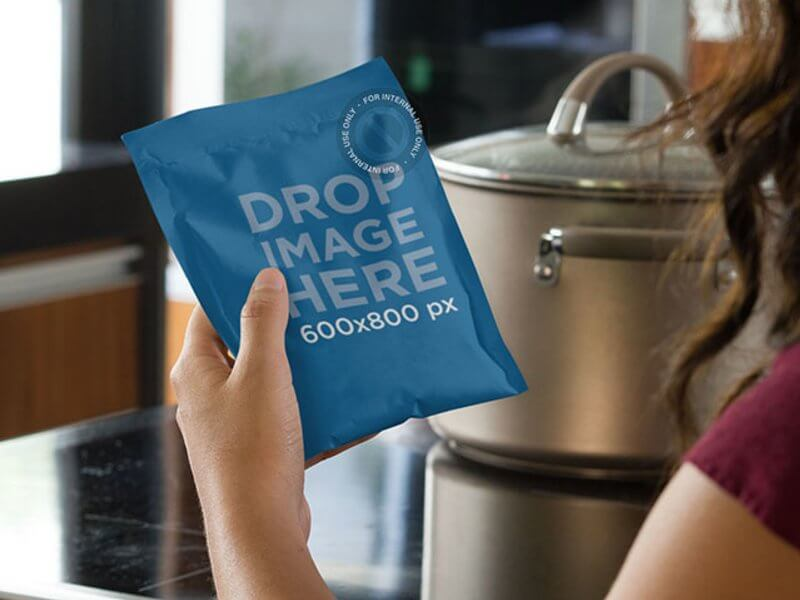 Label Mockup Featuring a Woman Holding a Bag of Dry Soup