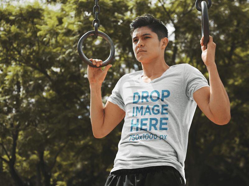 T-Shirt Mockup of a Man Exercising on Gymnastic Rings