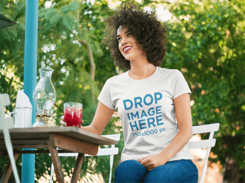 Tee Mockup of a Young Woman Having a Drink