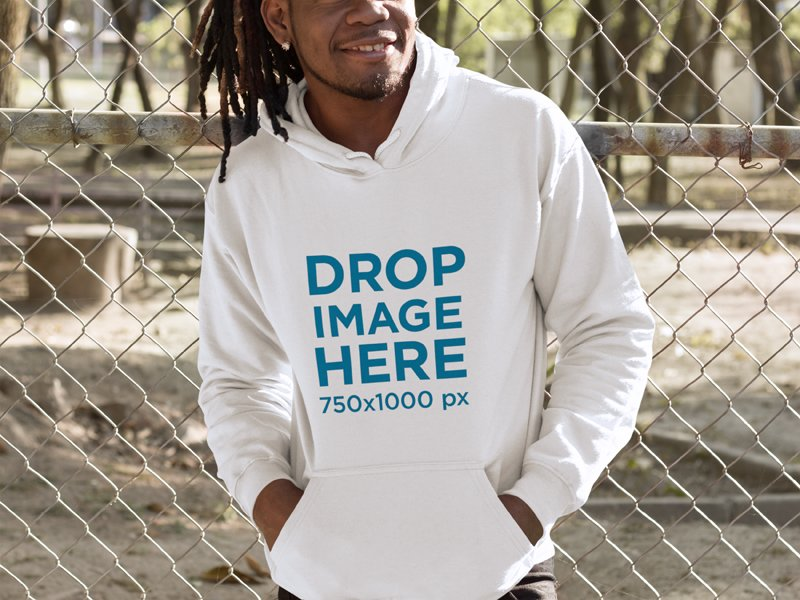 Smiling Black Man Leaning on a Fence Hoodie Mockup