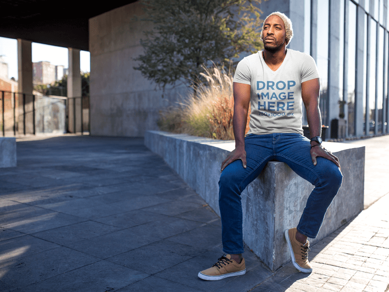 Black Man Sitting on a Concrete Planter T-Shirt Mockup