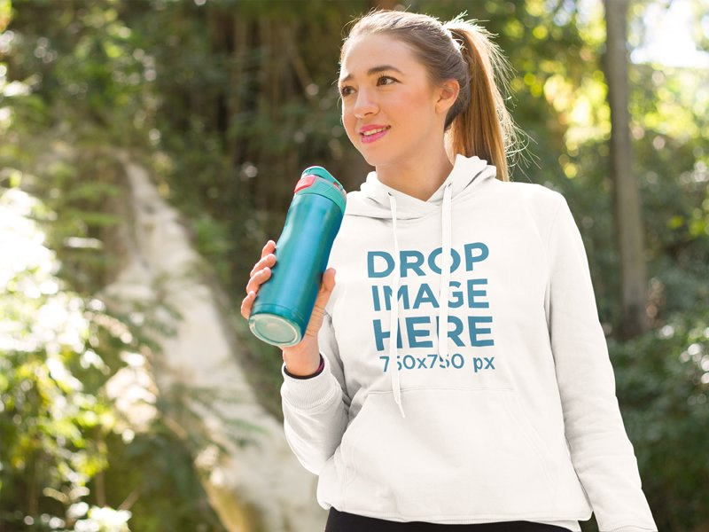 Young Woman at a Park Drinking Water Hoodie Mockup