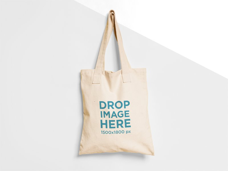 This Tote Bag Mockup Features A Hanging From Nail On Two Colors Wall You Can Almost Feel Its Texture Change The In Background To