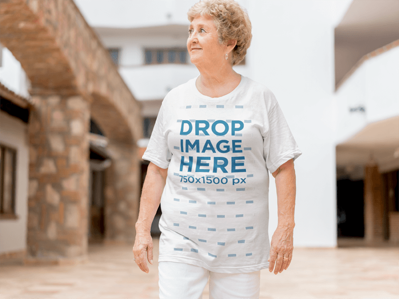 Smiling White Elderly Woman Wearing a T-Shirt Mockup