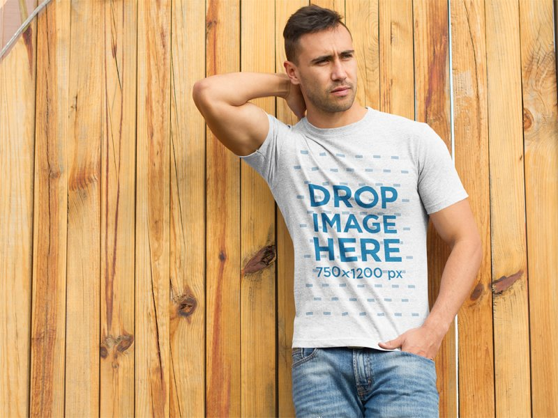 eb4683e8 default_a68f7616cfba381c7f34b4b98dbad7d6. This bella + canvas t-shirt mockup  of a man leaning against a wooden ...