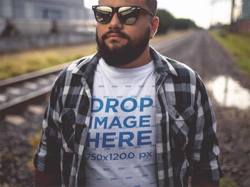 Plus Size T-Shirt Mockup of a Guy Wearing a Plaid Shirt and Sunglasses