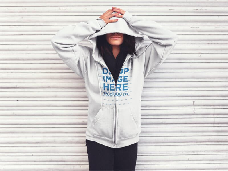 ZIP UP HOODIE MOCKUP FEATURING A GIRL IN THE STREET WITH HER FACE COVERED