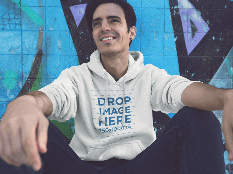 Pullover Hoodie Mockup of a Young Man Sitting and Having Fun at a Skate Park