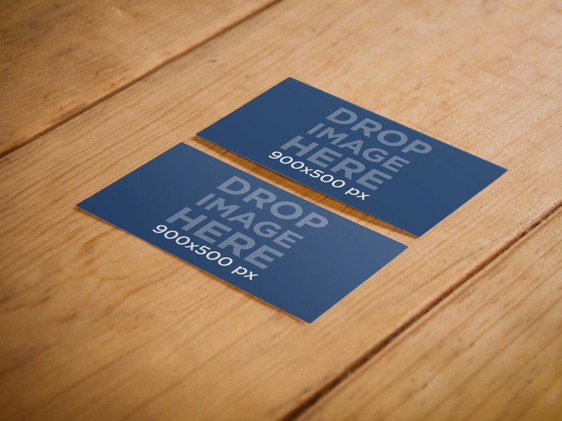 TWO SIDED BUSINESS CARD MOCKUP OVER A WOODEN SURFACE