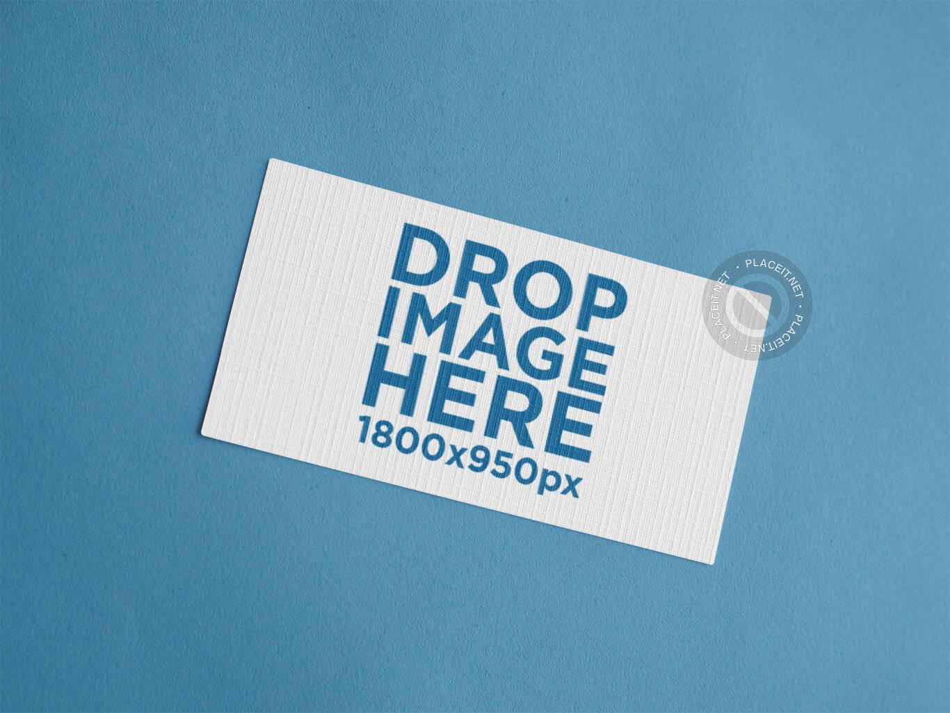 NICE AND CLEAN EMBOSSED BUSINESS CARD MOCKUP TEMPLATE OVER A BLUE BACKGROUND