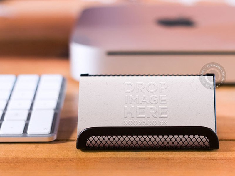 PHOTOREALISTIC BUSINESS CARD MOCKUP ON A DESKTOP BUSINESS CARD HOLDER