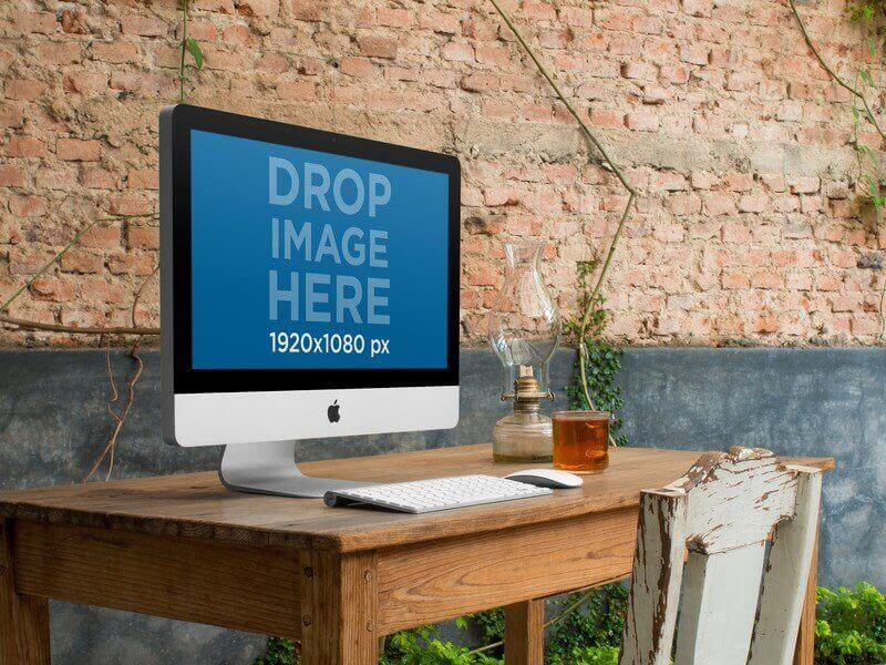 iMac mockup at a rustic setting