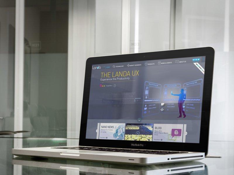 macbook-pro-over-glass-desk-in-business-room